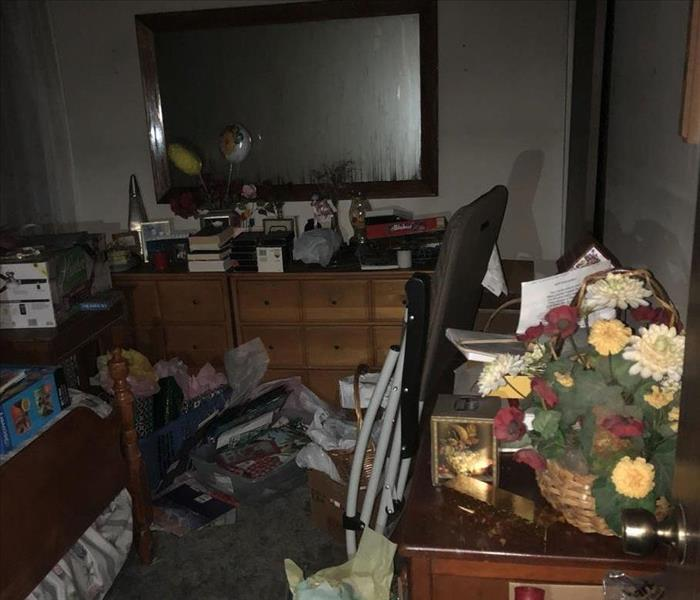 A bedroom damaged by a fire.