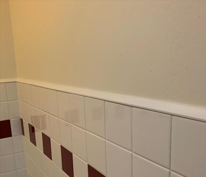 A bathroom wall completed after reconstruction.